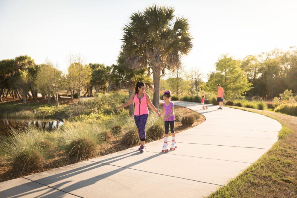 kids family on sidewalk trail in laureate park